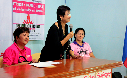 Dr. Ederlinda M. Fernandez-WMSU Vice President for Planning, Administration and Finance and an active women's rights advocate (center) during the forum discussion invites the community women leaders and other participants to join in the One Billion Rising event as Prof. Rosalyn Echem (right) and Representative Ilagan (left) looks on.