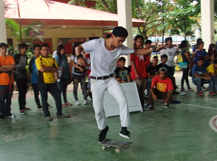 A Skateboarding student exhibits his stunts along with other contestants during the Skate Boarding Competition on Tuesday at the WMSU Covered Court.