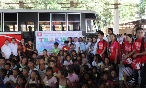 WMSU officials, volunteers of the Save Our Children and Badjao children evacuees posed at the WMSU covered court.