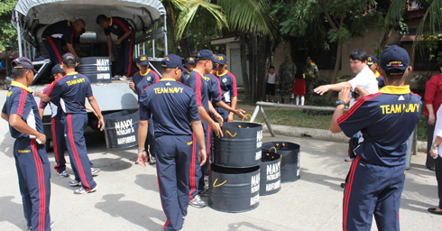Naval Forces of the CMOU of WESMINCOM unloaded the trash cans from their truck.