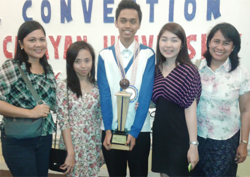PolSci debate team with CSS faculty members showing off the trophy for winning the debate cup.