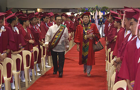 University President Dr. Grace J. Rebollos during the processional together with the event's honored guest speaker, DOH Secretary - Dr. Enrique T. Ona