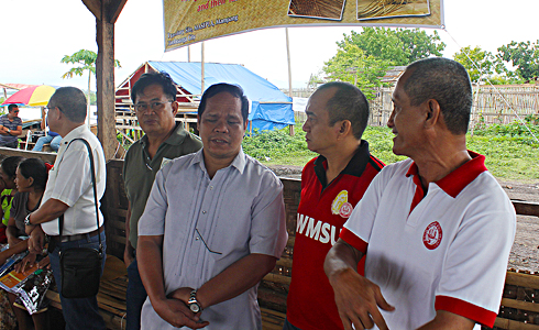WMSU's delegates to the launch, project proponent and DES-NFE Dean Prof. Lucio C. Somblingo (extreme right) and Auxiliary Director, Mr. Eric Alfaro (2nd from right) dialogues with DOLE IX Regional Director Dir. Sisinio B. Cano (3rd from right).