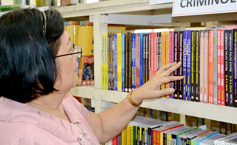 University officials like BIDANI Chair, Prof. Eulyn H. Tangalin, check out some books available at the library.