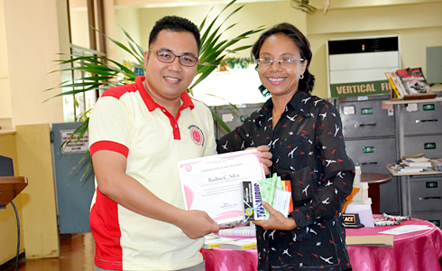 University Librarian, Mr. Benhur Asid, with the best library user (faculty category), Ms. Rodita Silva.