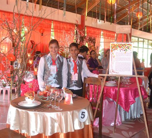 Cathleiyah S. Cariaga and Ruby Claire M. Rono won third place in the table setting competition.